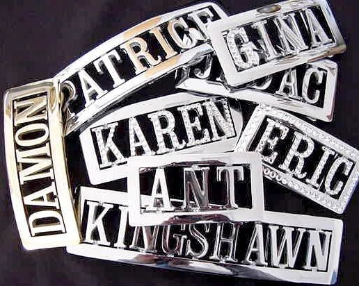 A collection of nine sliver personalized belt buckles -- with the names on it being Damon, Patrice, Gina, Jadac, Eric, Karen, Ant, and King Shawn.