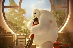 A robot giving a kid a big, nice hug