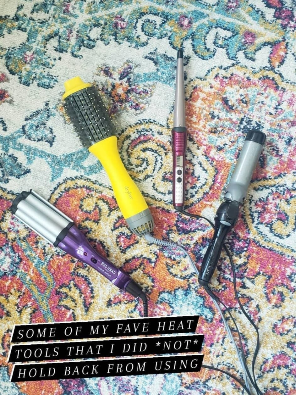 """The writer's waver, hot air brush, wand, and curling iron laying on the floor with the caption, """"Some of my fave heat tools that I did not hold back from using"""""""