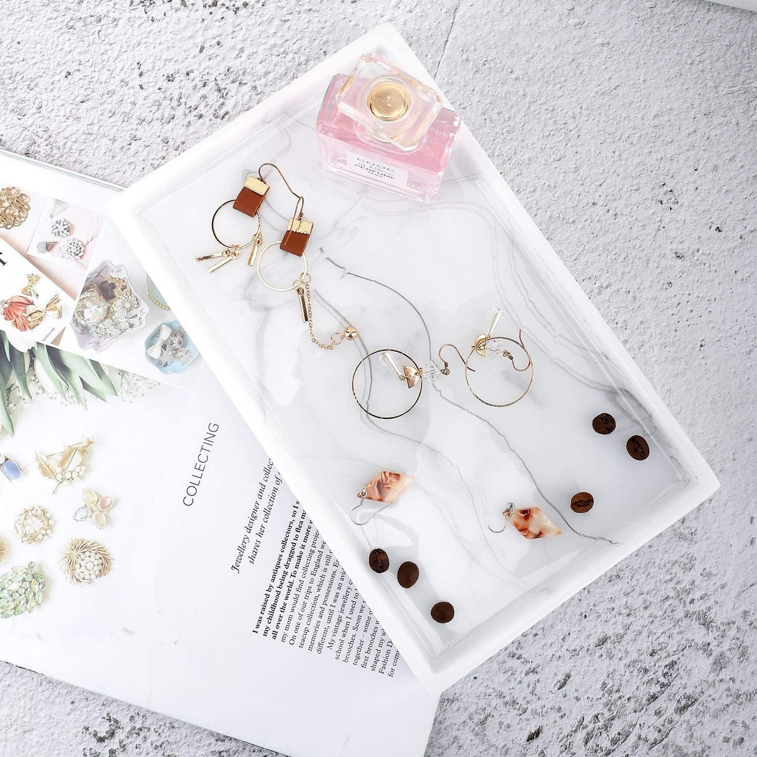 Jewelry laid out on the marble tray