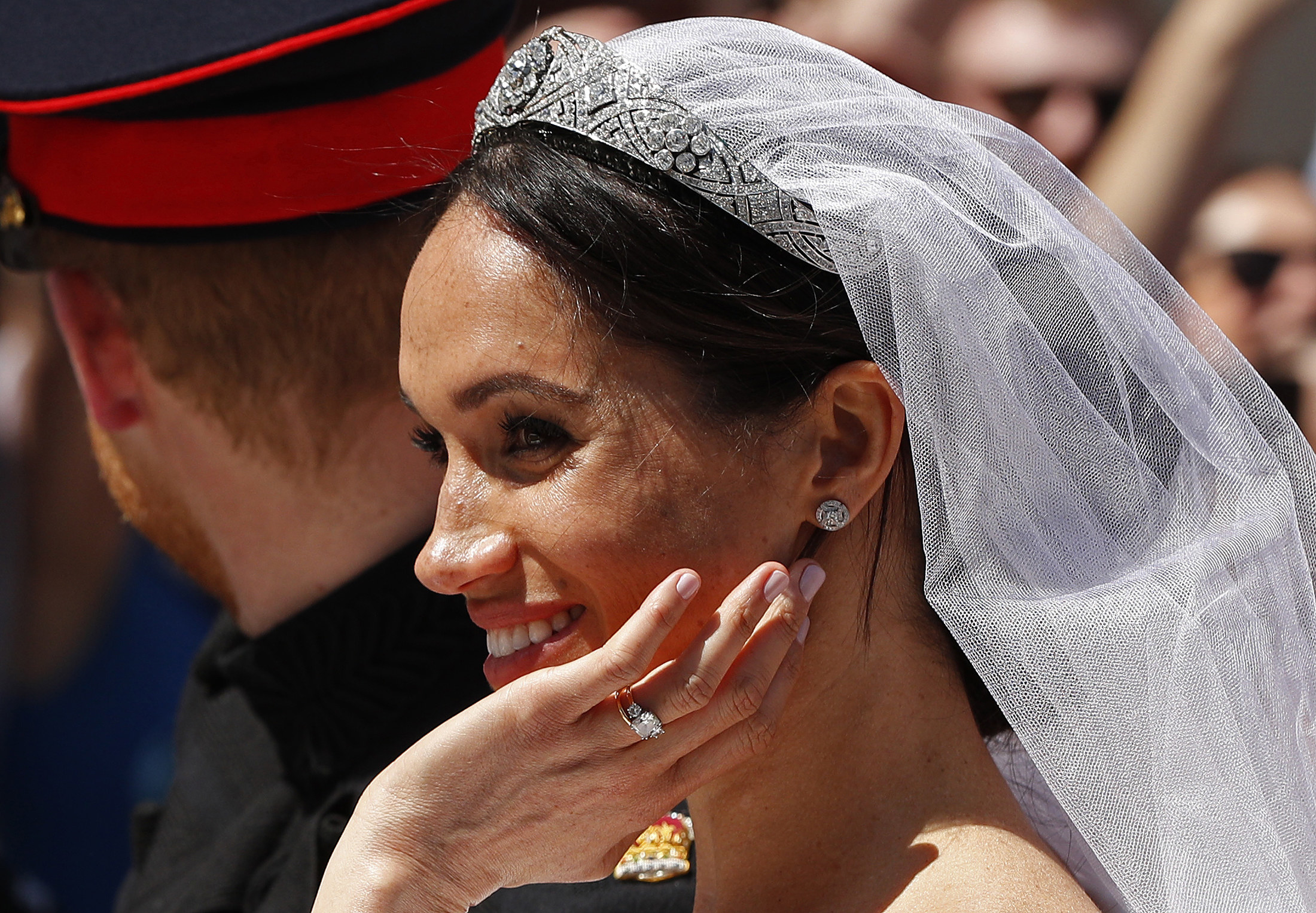 A close up of the Duchess of Sussex, showing her tiara, and engagement ring.