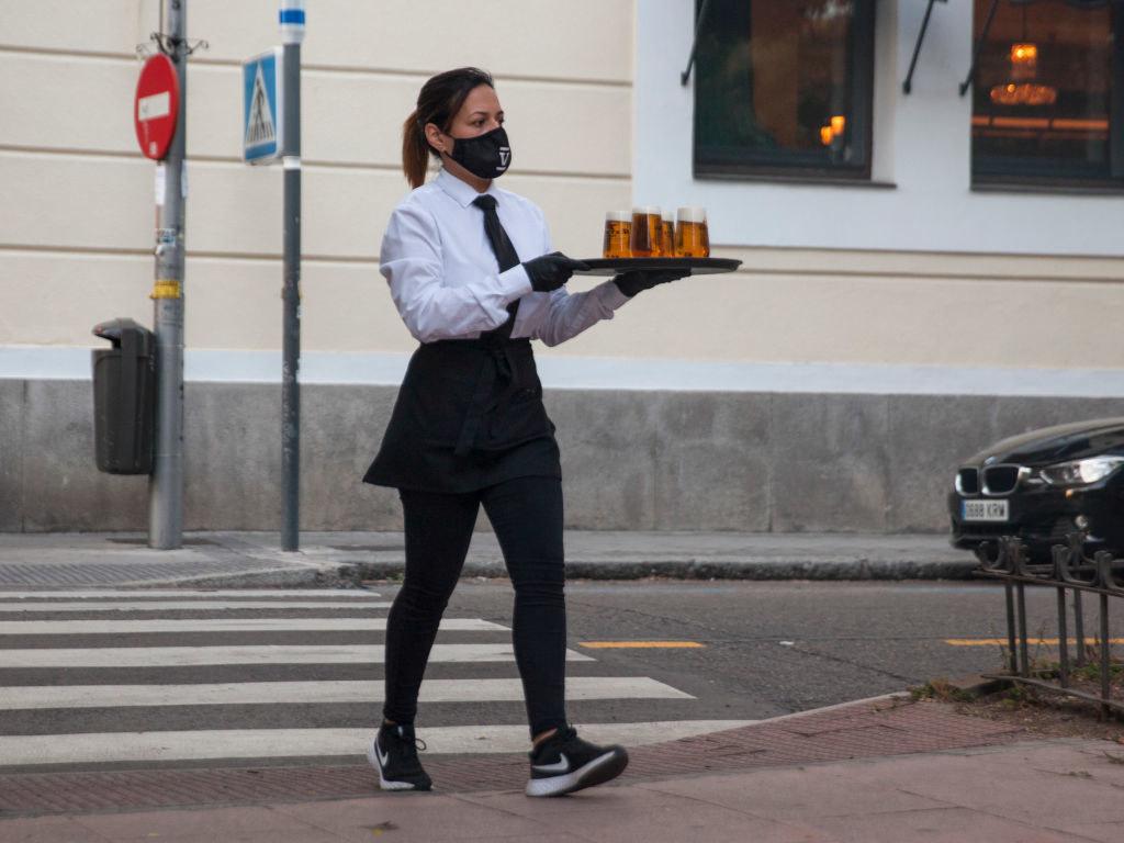 Server delivering drinks across the street