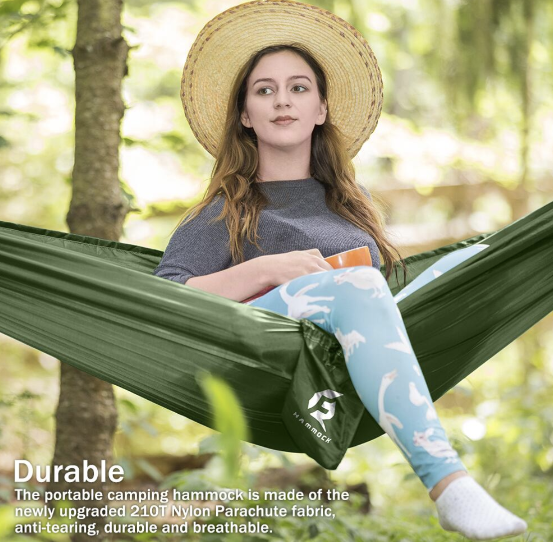 Model sitting on the green hammock outside