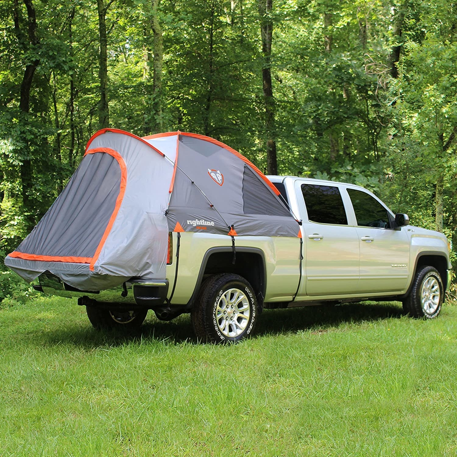 A truck with a tent covering the opened bed