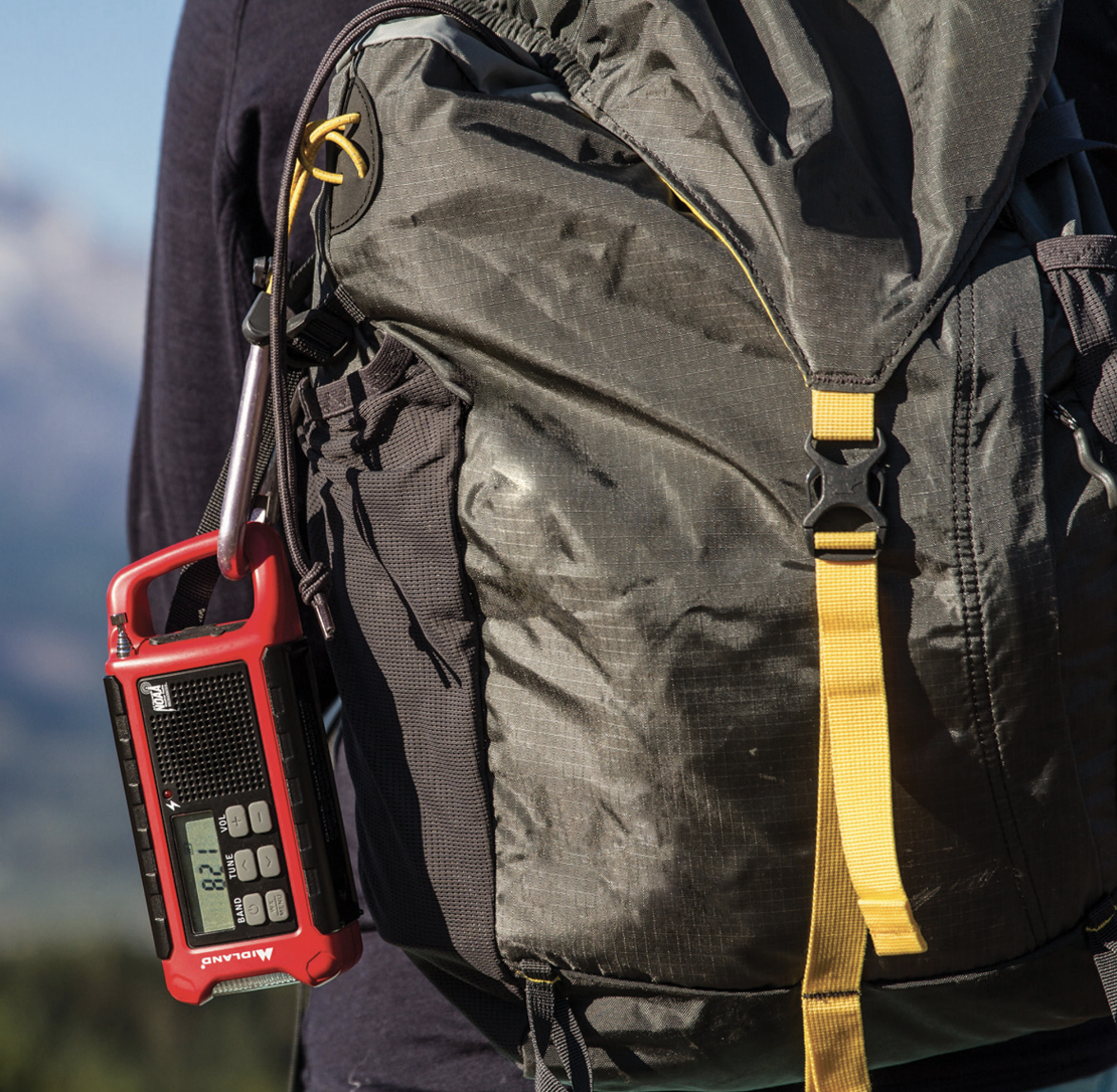 The red weather radio attached to a backpack