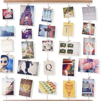 The brown wood rack set up hanging vertically, holding photos and postcards