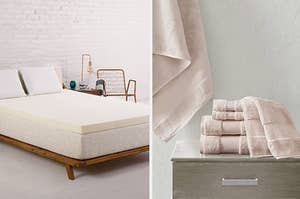 On the left, white mattress topper on a white mattress. On the right, a pile of soft pink towels on a gray table