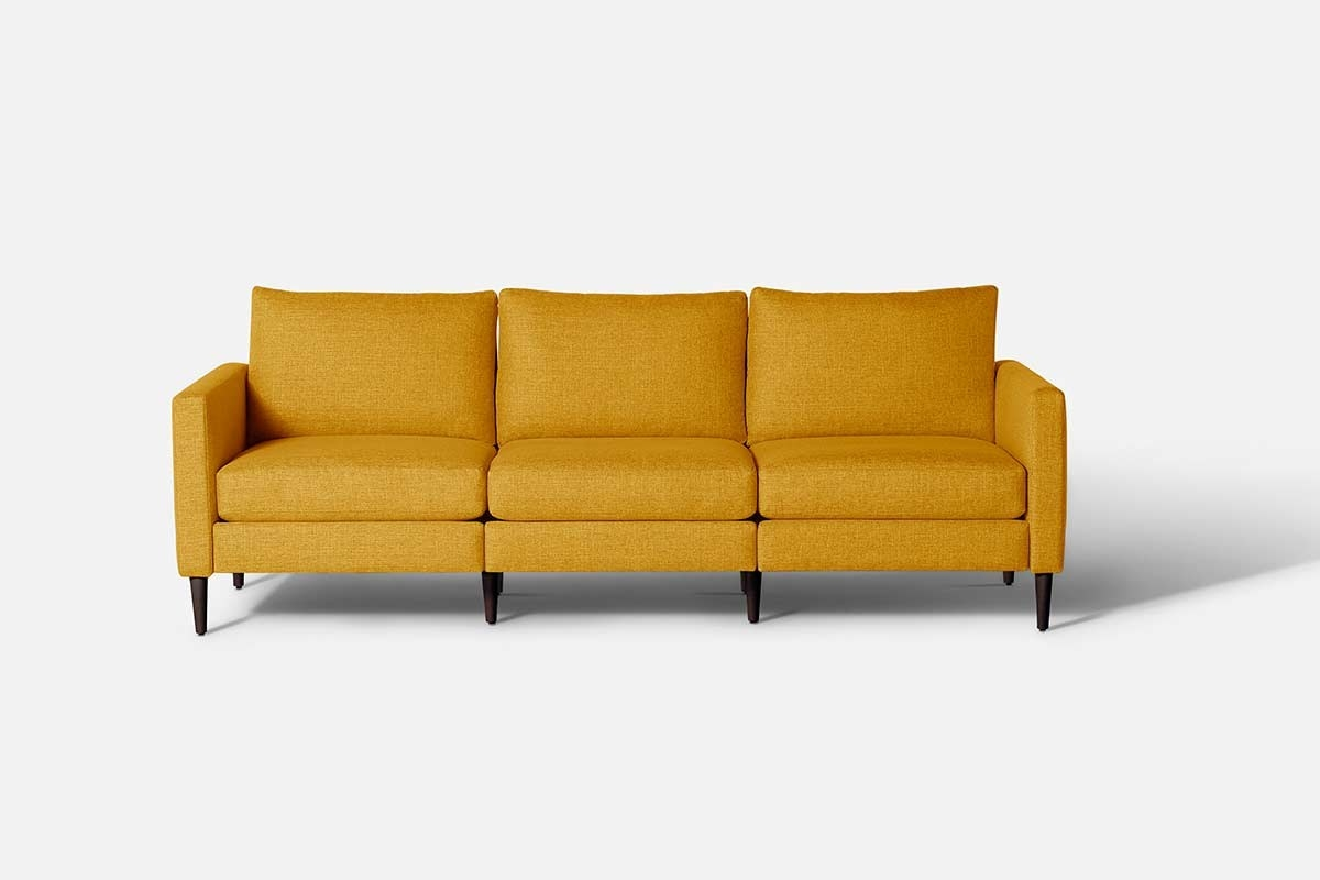 Mustard yellow three-seater couch