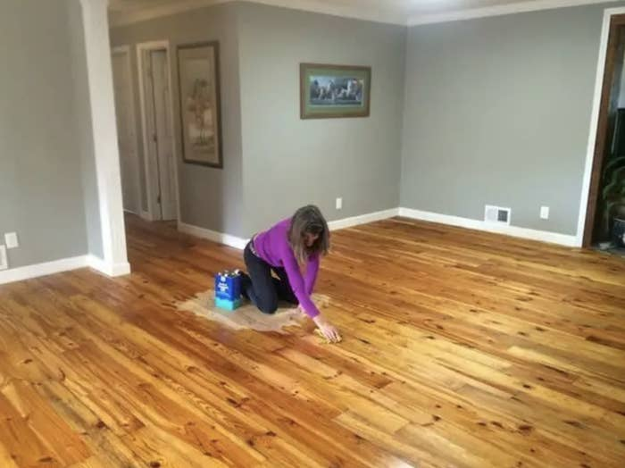 woman in the middle of a freshly painted floor