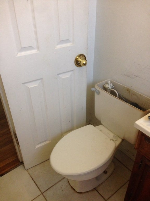 toilet blocking a door from closing