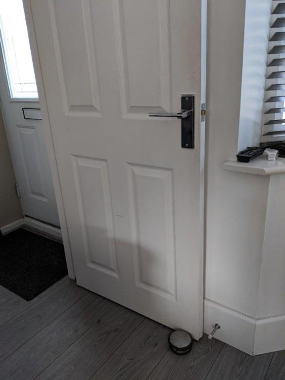 door is blocked by a doorstopper
