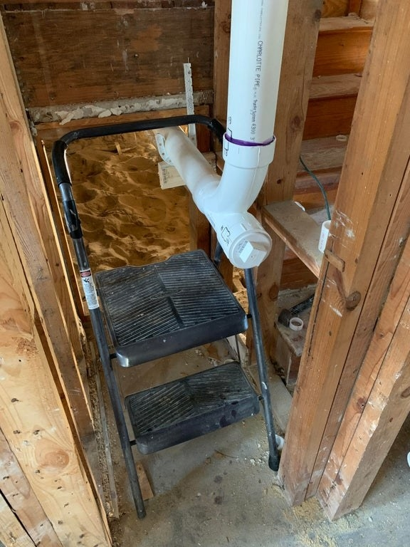 a stepladder is locked into a pipe