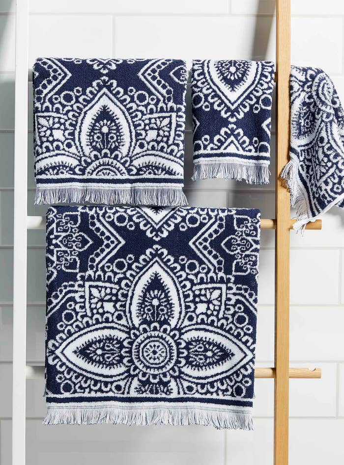 A pattern towel hanging on a wooden rack