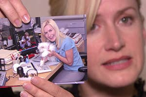 Angela holding up a picture of her and one of her cats