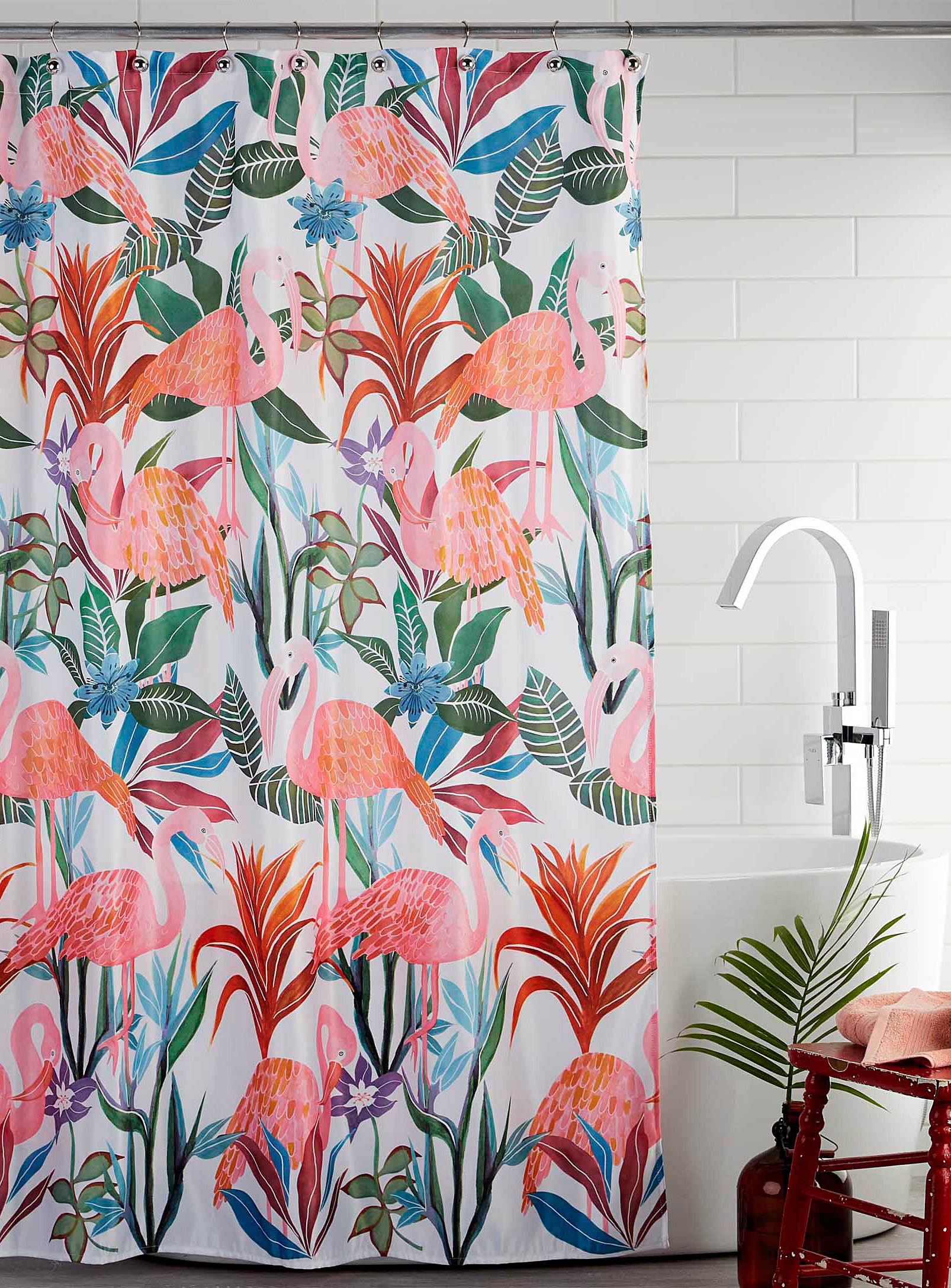A shower curtain with flamingos printed on it