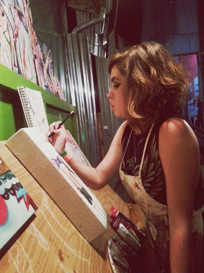 Elizabeth Baggett sketching a piece of art
