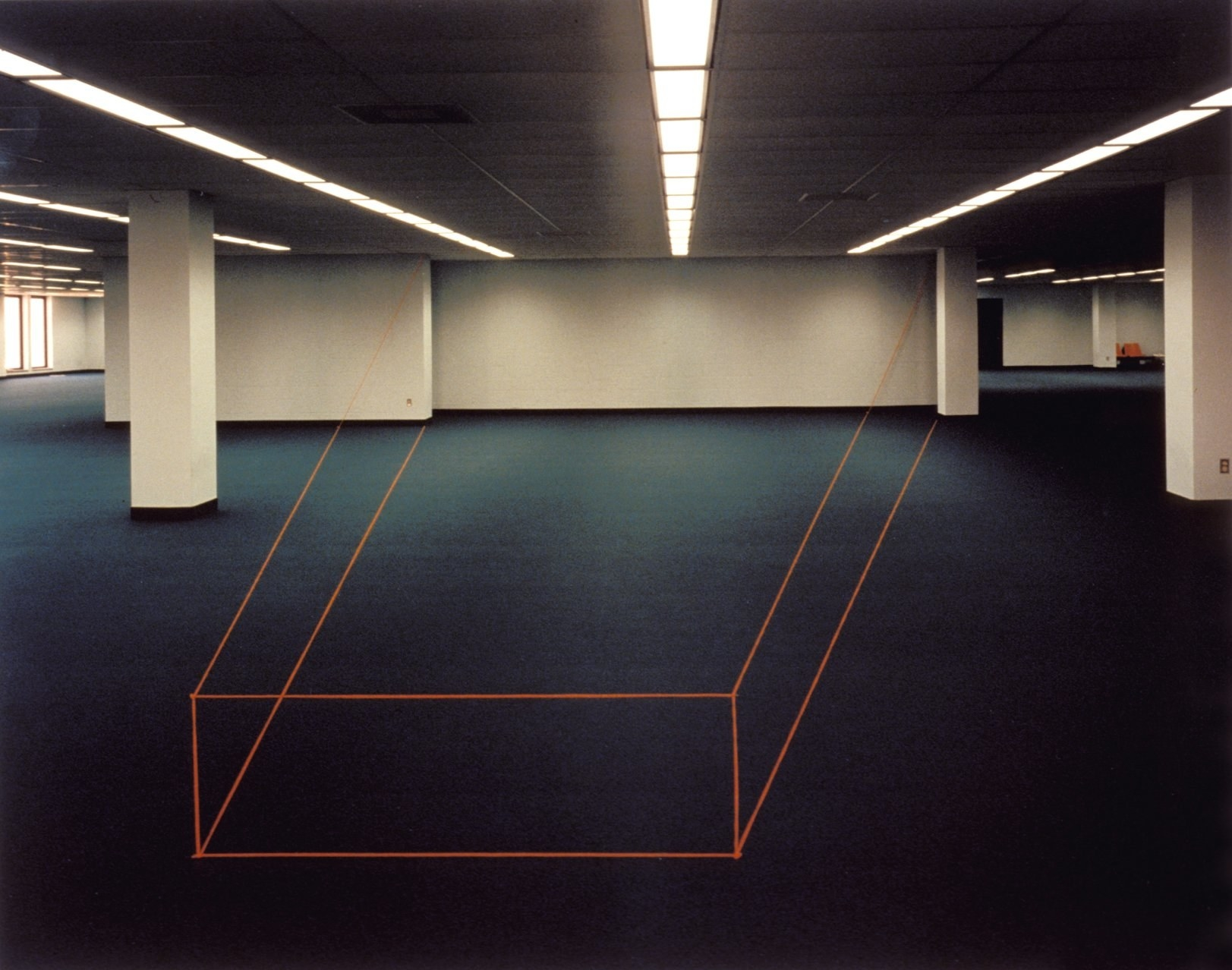 A wall is turned into a cube using tape on the floor