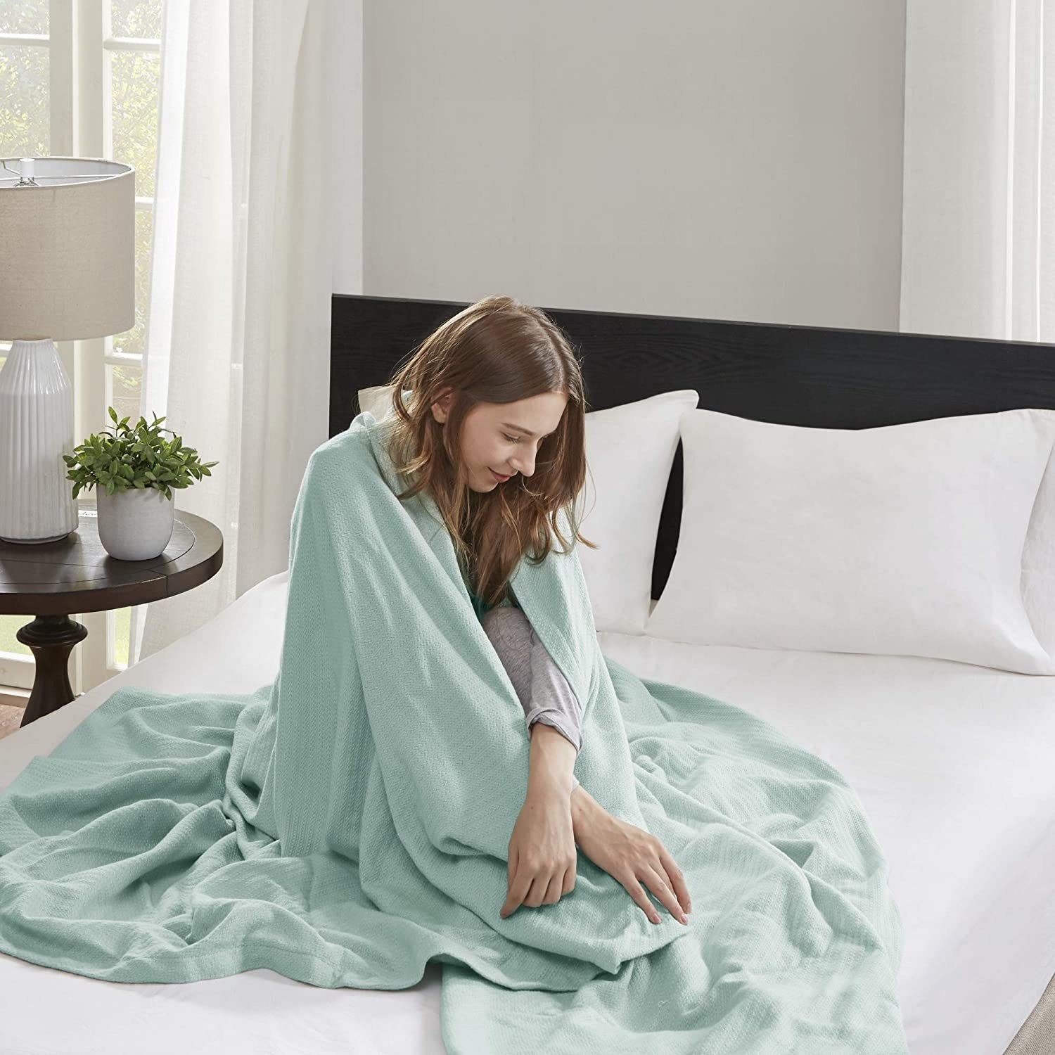 Model with throw blanket wrapped around their body
