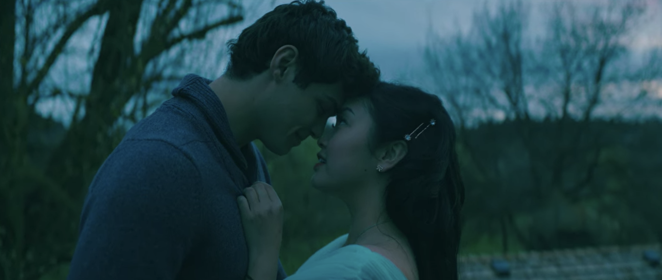 Lara Jean and Peter staring at each other lovingly while they float into the sky.