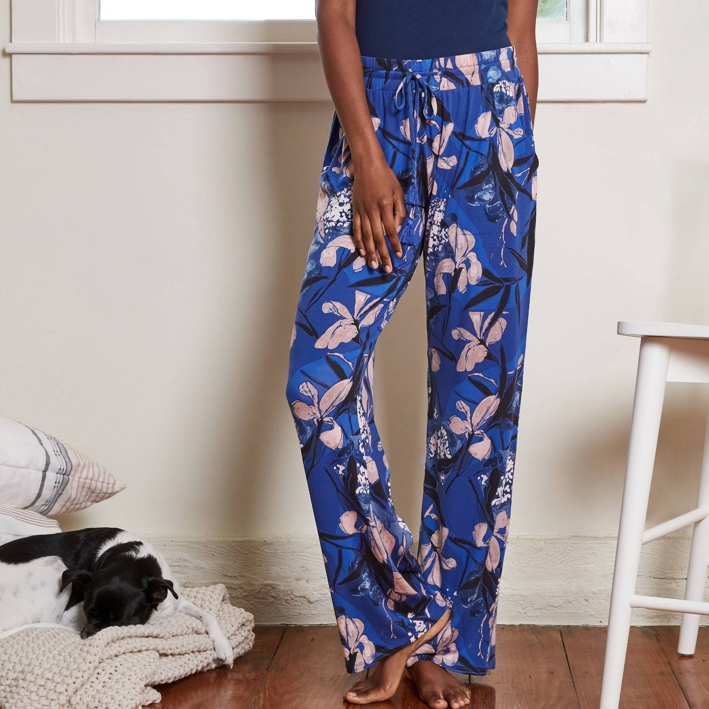 model wearing blue pajama pants with floral design