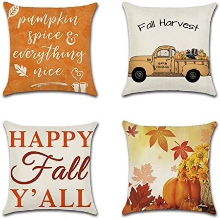 A pillow that says pumpkin spice and everything nice a pillow that says fall harvest a pillow that says happy fall ya'll and a pillow with leaves and pumpkins