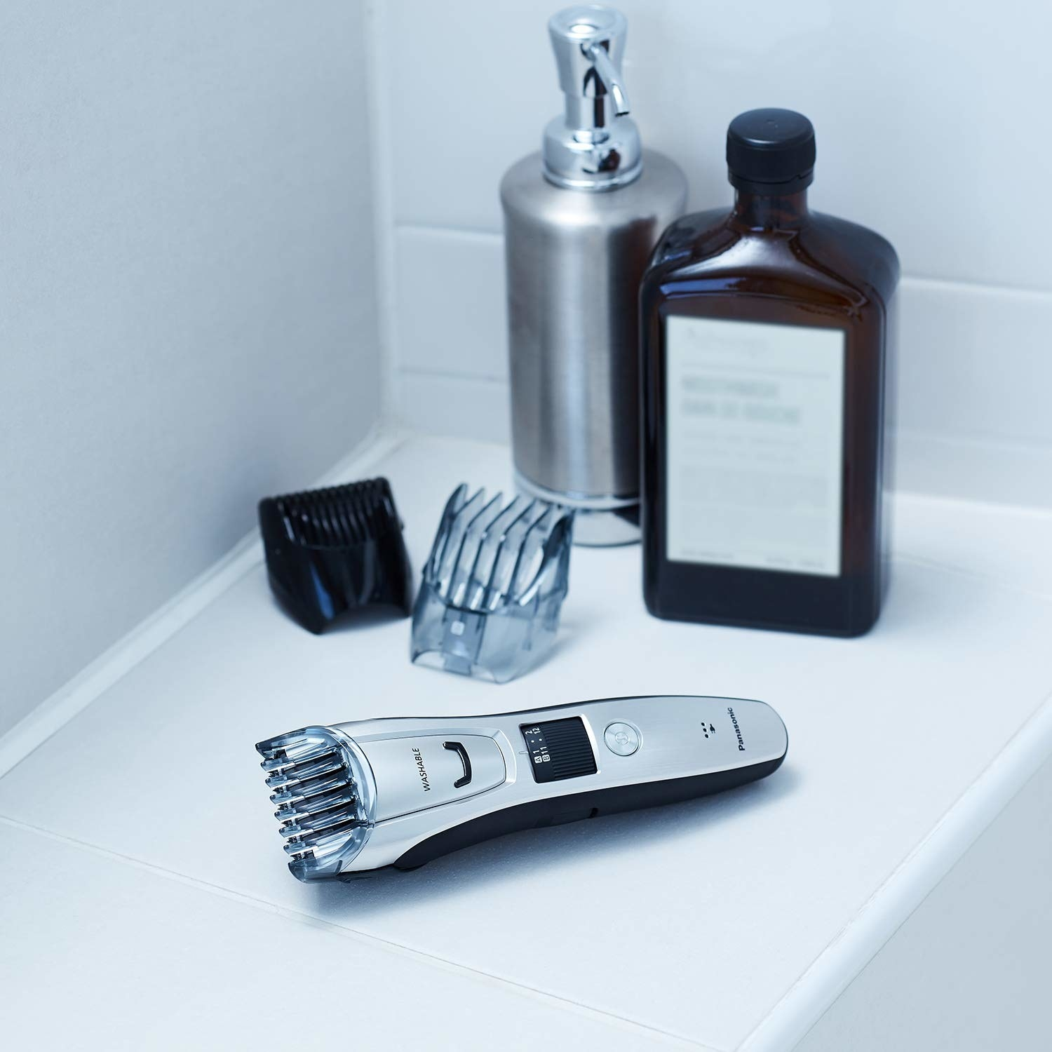 The trimmer with two additional comb attachments