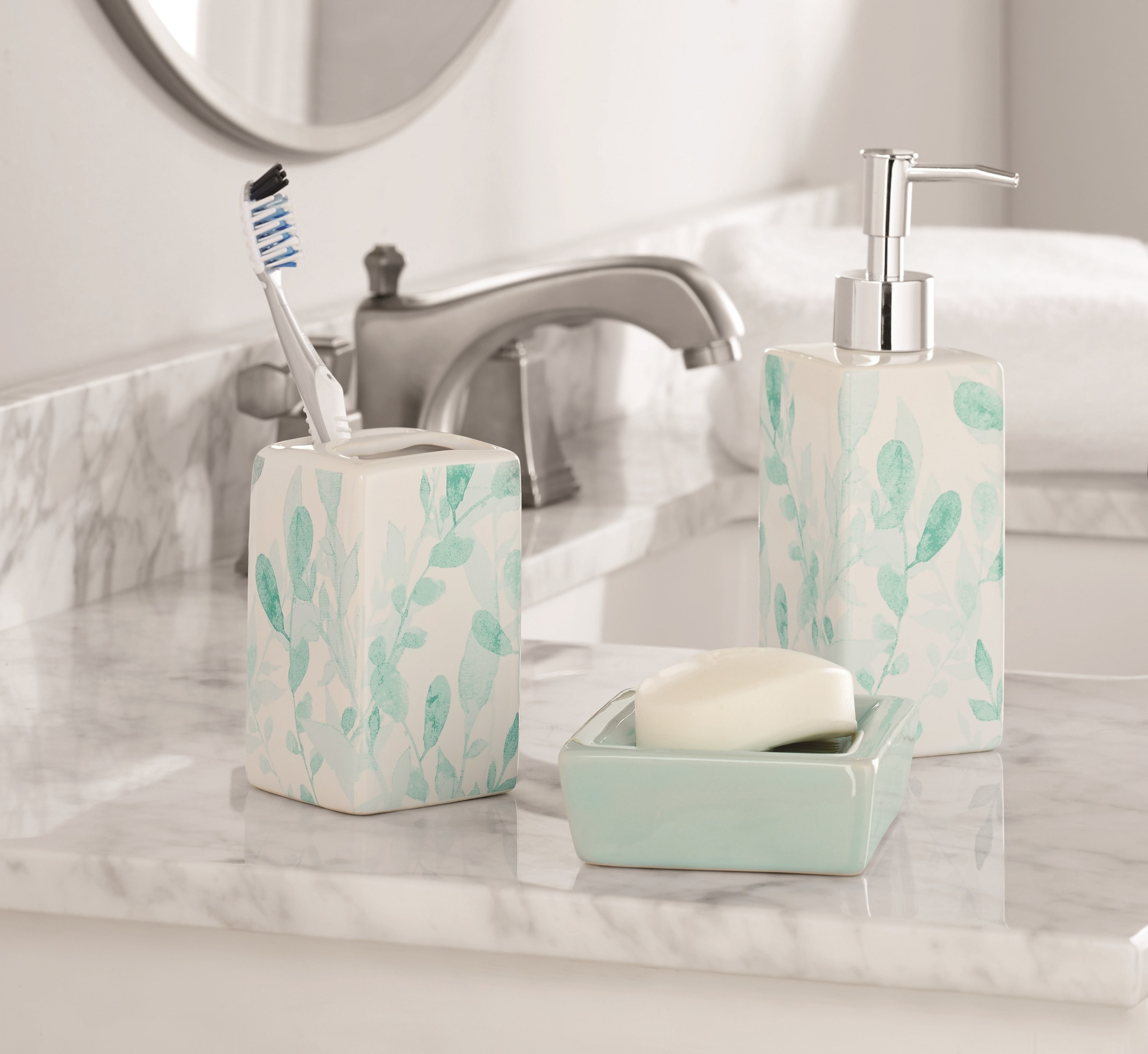 The toothbrush holder, soap dispenser, and soap bar holder in light green leaf pattern