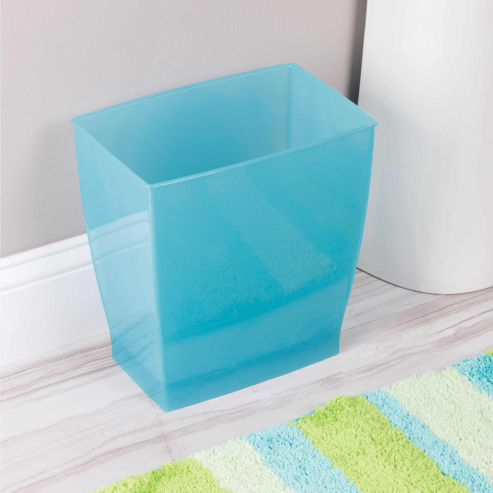 The blue rectangular trash can