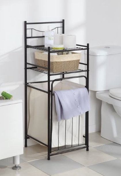 The black metal storage tower with bottom hamper and two top shelves