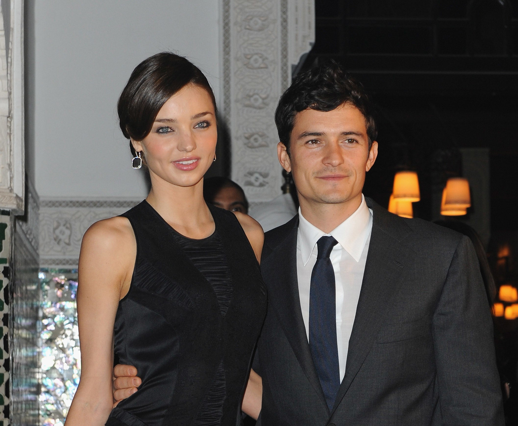 Miranda Kerr in a black gown and Orlando Bloom in dark grey suit and navy tie at an even in 2009.