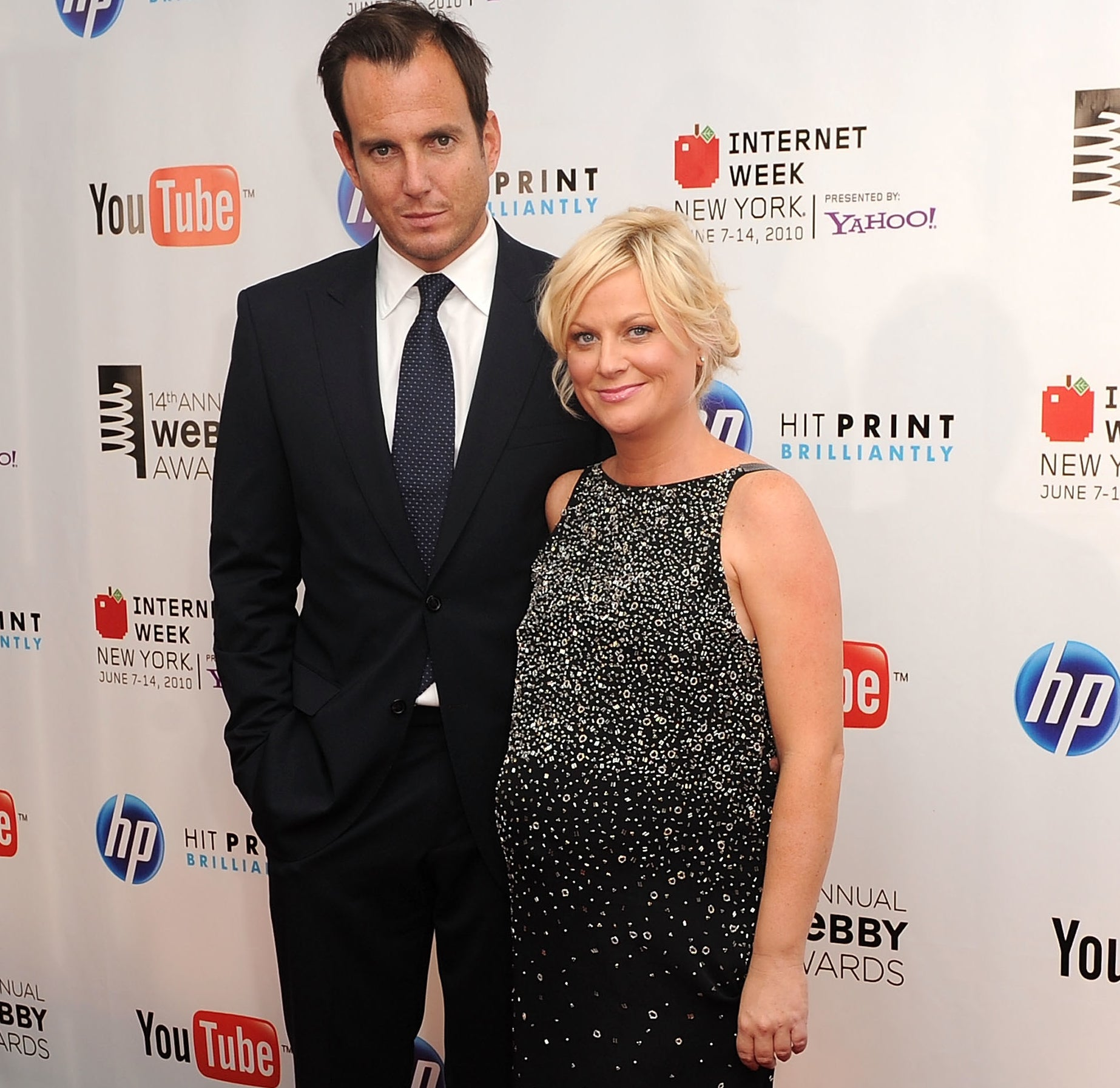 Will Arnett and Amy Poehler (who is pregnant and wearing a black stoned cocktail dress) on the red carpet of the 14th Annual Webby Awards in 2010