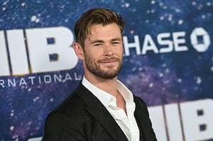 Chris Hemsworth smiles at the premiere for Men in Black International