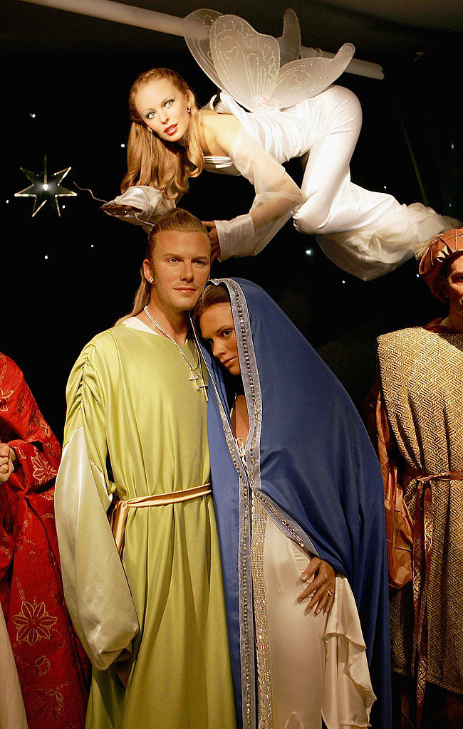 Wax figures of David, Victoria, and Kylie, all dressed up