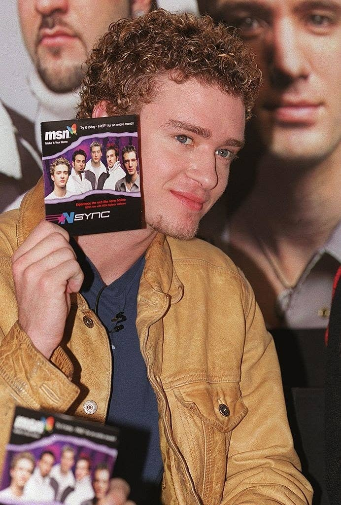 Justin Timberlake holding the NSYNC MSN CD