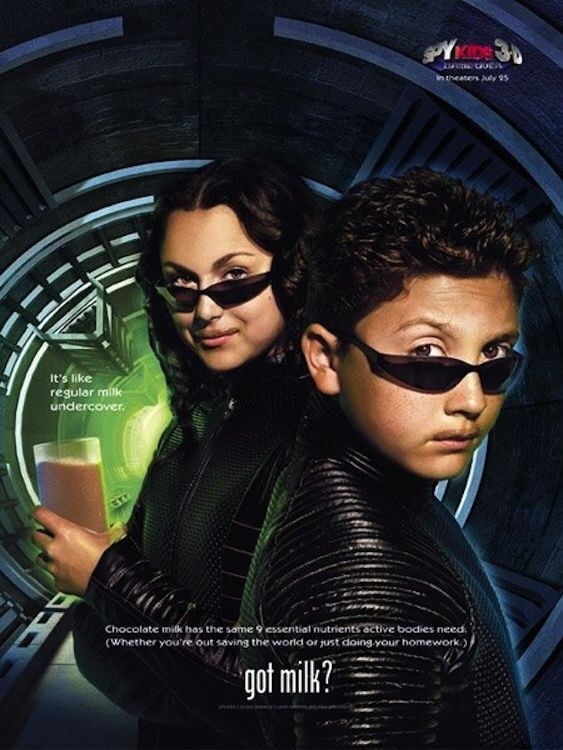 """The """"Spy Kids"""" kids looking mysterious with the caption, """"It's like regular milk, undercover"""""""