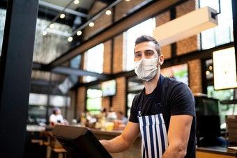 A server wearing a mask