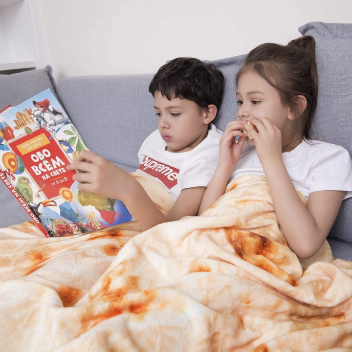 Two kids under the blanket reading
