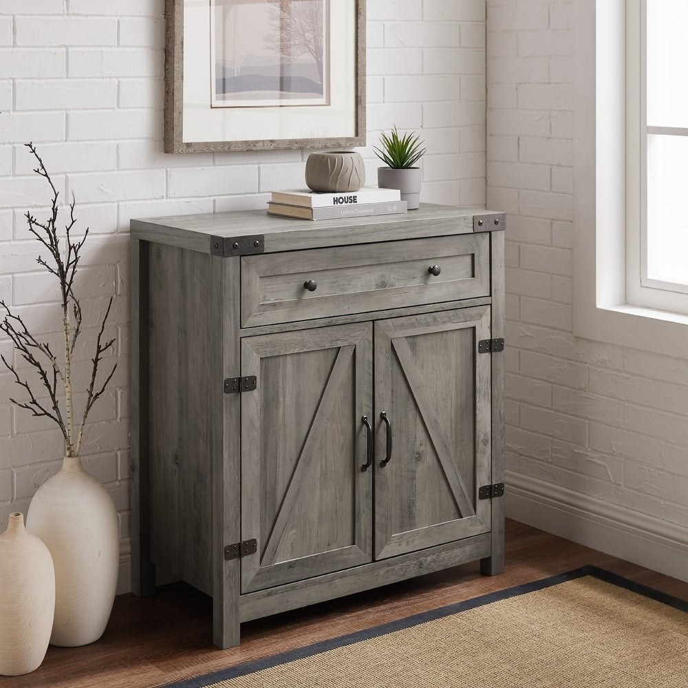 A grey wooden two-door cabinet with a drawer on top