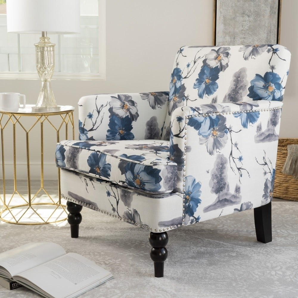 The white armchair with blue and gray flowers on a white background