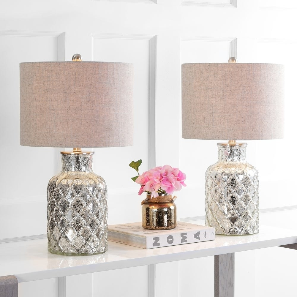 Two lamps with textured antique-looking silver bases