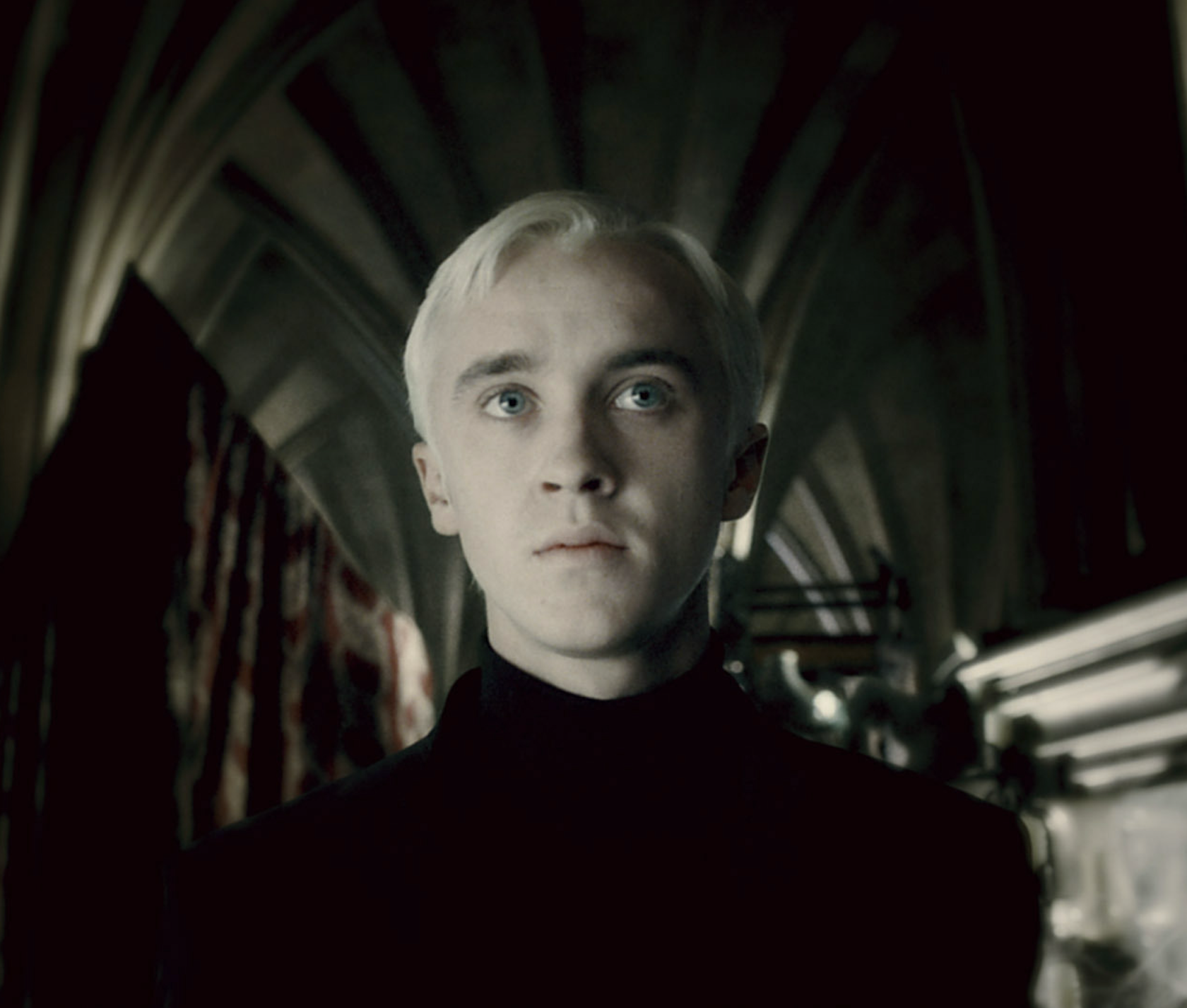 Draco standing in the Room of Requirement