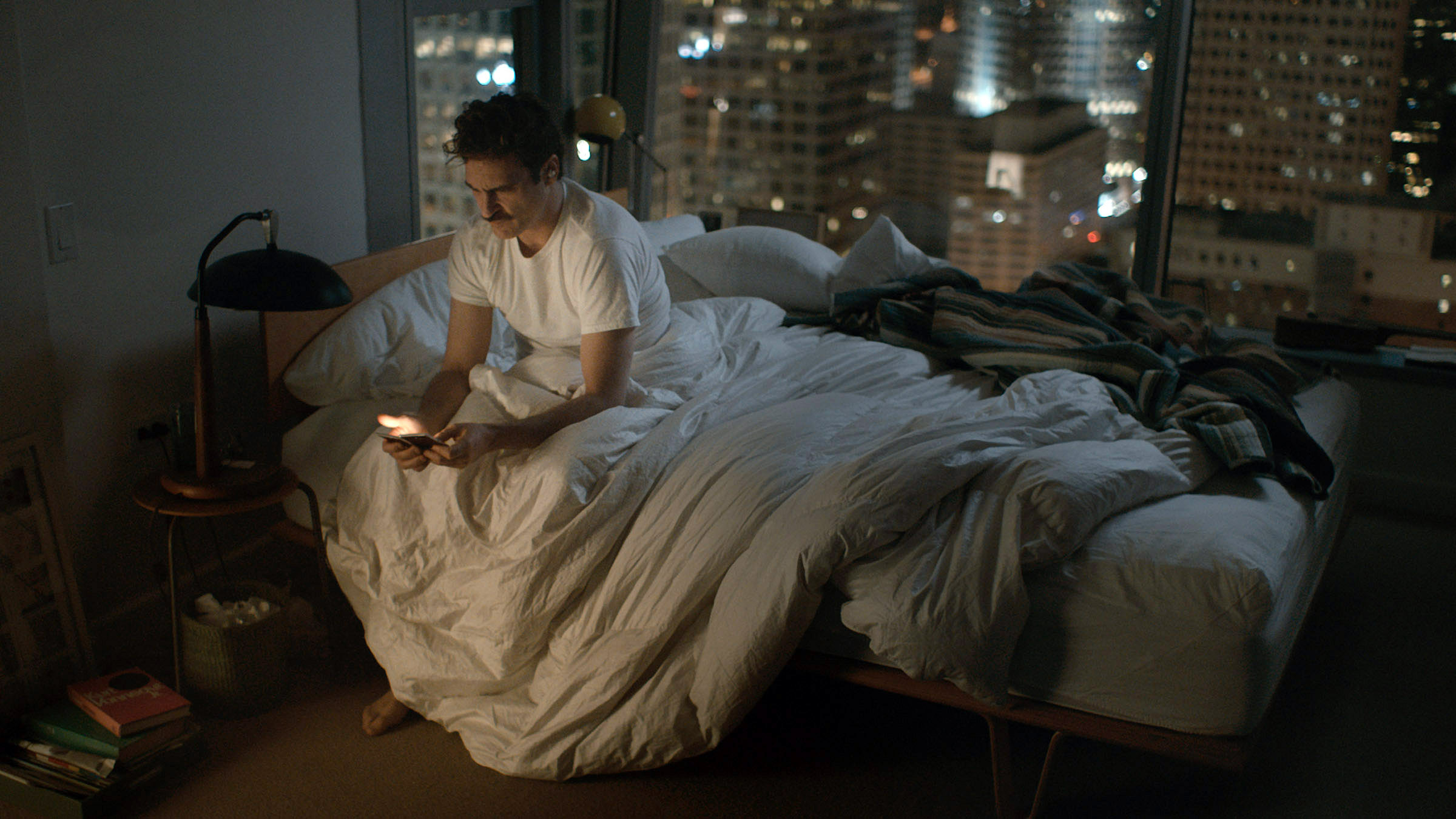 Theo on the phone in bed