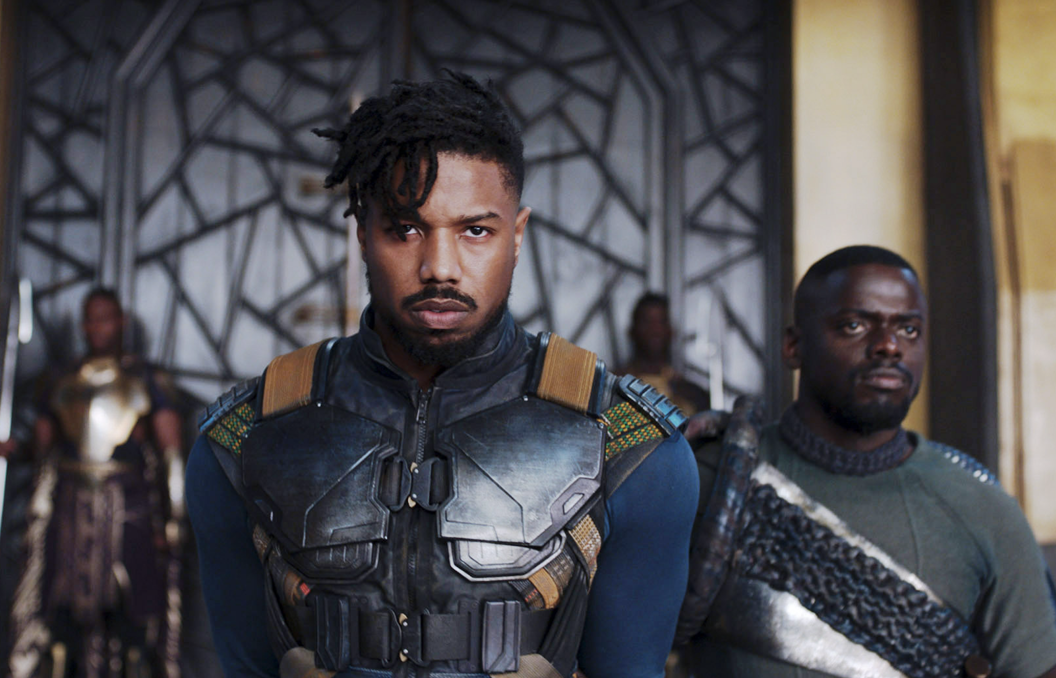 Killmonger walking into a room with guards