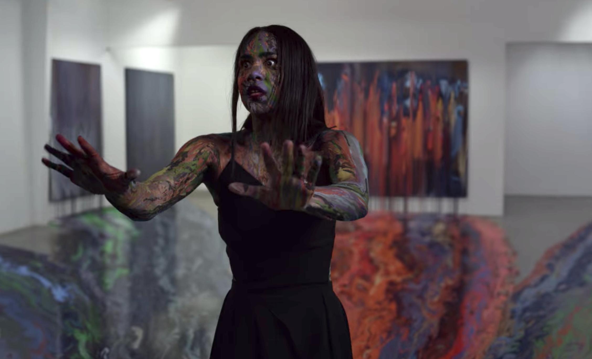 Josephina panicking as the paintings melt on her