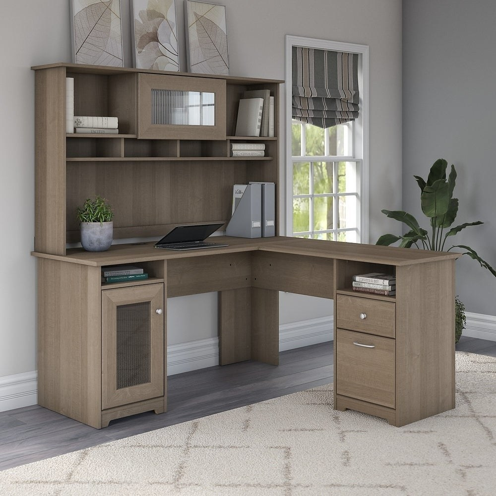 The L-shaped desk setup with two drawers and a hutch of shelves over one leg of the L