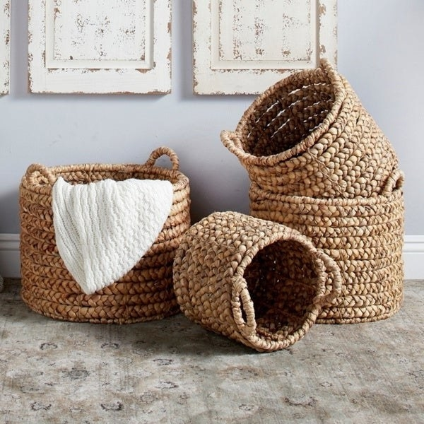 Four round wicker baskets in small, medium, and large sizes