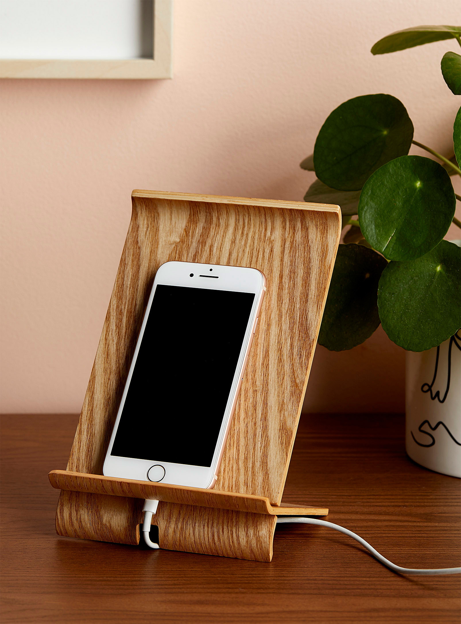An iPhone on the wooden stand
