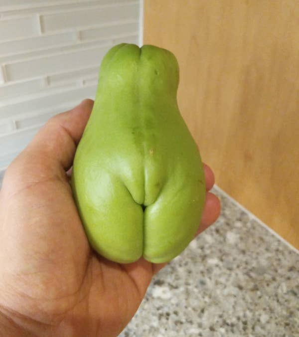 A pear that looks like it has legs and a vulva