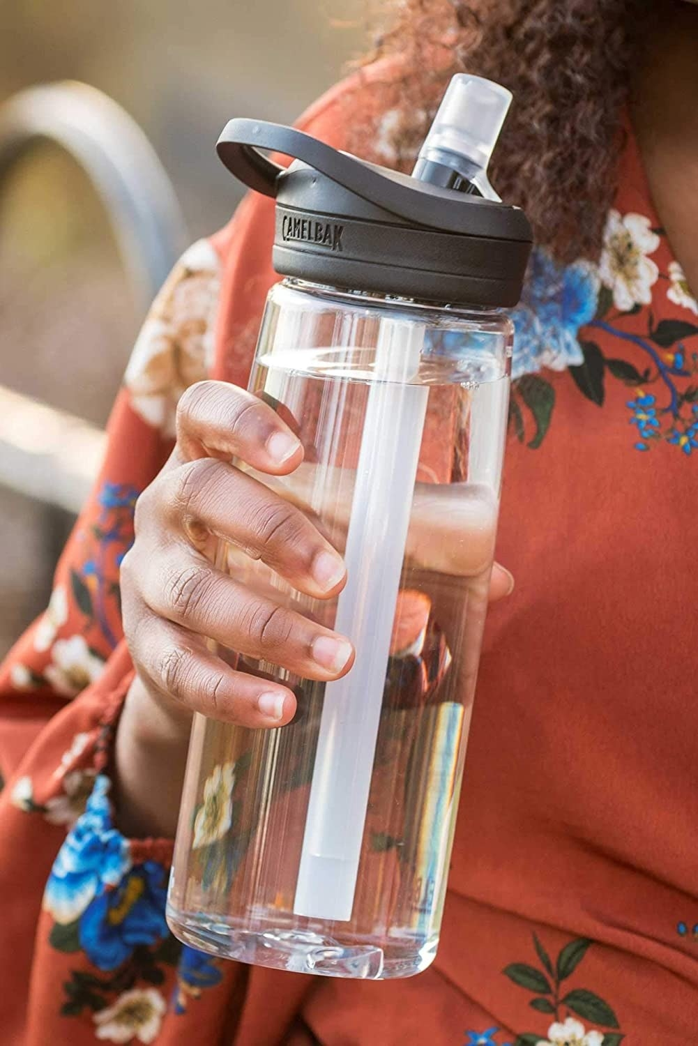 Product photo showing the CamelBak Eddy water bottle in clear with the bite-valve straw popped-up.