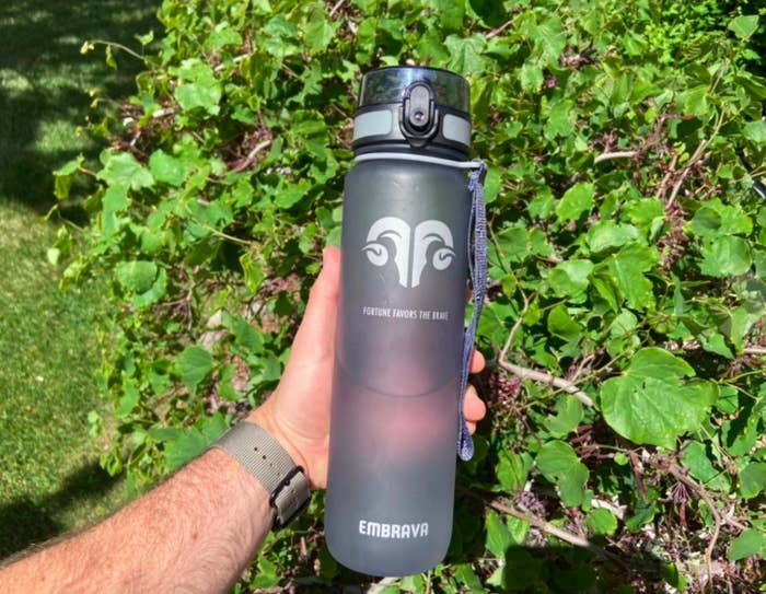 Reviewer photo of the reviewer holding the Embrava water bottle comfortably with one hand.